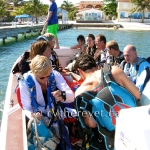 Water taxi filled with happy skydivers