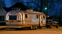 Our Airstream in the glow of night.