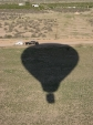 Chase vehicle driving on balloon shadow